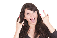 Beautiful playful girl gesturing rock and roll Royalty Free Stock Photography