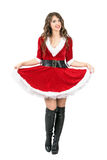 Beautiful playful Santa Claus woman lifting skirt with petticoat posing at camera Stock Photo
