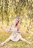 Beautiful playful woman under birch tree, outdoors, people Stock Photography