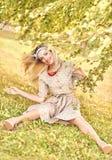 Beautiful playful woman under birch tree, outdoors, people Stock Photos