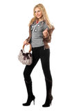 Beautiful playful young blonde with a handbag stock images