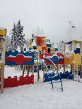 Beautiful playground in the snow in winter. After the snowfall. royalty free stock photo