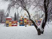 Beautiful playground in the snow in winter. After the snowfall. stock images