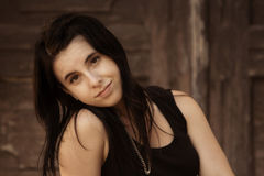 Beautiful, pleasant Caucasian teen female with dark hair Stock Photos