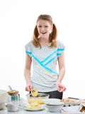 Beautiful pleasant girl prepares baking in kitchen. The beautiful young cheerful girl on home cuisine cooks dough for easter pie Royalty Free Stock Photography