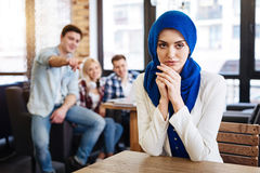 Beautiful pleasant muslim woman sitting in the cafe Royalty Free Stock Photos