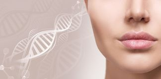 Beautiful plump female lips among DNA chains. royalty free stock photo
