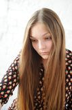 Beautiful plump teen girl with long hair Stock Photo