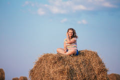 Beautiful Plus Size Girl Sitting On A Haystack And Stock Image