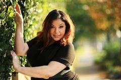 Beautiful plus size model. Outdoors. Shallow DOF stock images