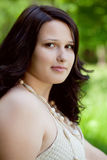 Beautiful plus size model outdoors. Looking at camera Stock Photo