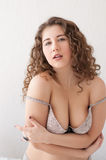 Beautiful plus size model sexy posing in lingerie Stock Photo