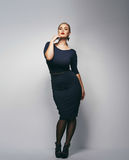 Beautiful plus size secretary in sexy dress Stock Photo