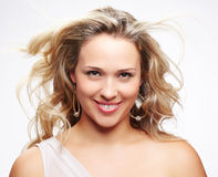 Beautiful plus size woman. Portrait of beautiful plus size curly young blond woman posing on gray Stock Images
