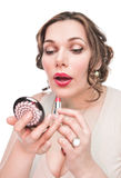 Beautiful plus size woman applying lipstick Royalty Free Stock Images