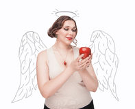 Beautiful plus size woman as angel with apple Royalty Free Stock Photo