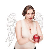 Beautiful plus size woman as angel suggest apple Royalty Free Stock Photos