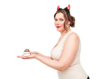 Beautiful plus size woman as devil with pastry Royalty Free Stock Photos