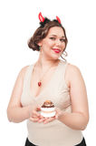 Beautiful plus size woman as devil with pastry Royalty Free Stock Images