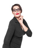 Beautiful plus size woman in black dress and glasses posing isol Royalty Free Stock Image