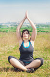Beautiful plus size woman doing yoga Stock Images