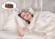 Beautiful plus size woman dreaming about cake Royalty Free Stock Image