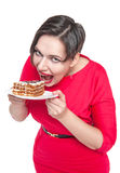 Beautiful plus size woman eating cake. Isolated over white Royalty Free Stock Images