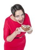 Beautiful plus size woman eating cake. Isolated over white Stock Photo