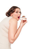 Beautiful plus size woman eating pastr. Y isolated Royalty Free Stock Image