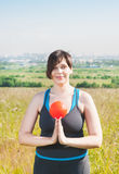 Beautiful plus size woman exercising with ball Stock Photos