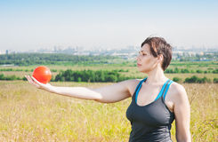 Beautiful plus size woman exercising with ball Royalty Free Stock Photo