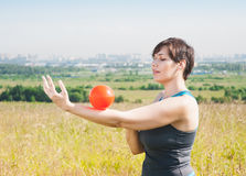 Beautiful plus size woman exercising with ball Stock Photo
