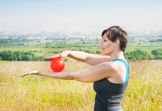 Beautiful plus size woman exercising with ball Royalty Free Stock Photography