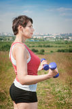 Beautiful plus size woman exercising with dumbbells Stock Photography