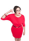 Beautiful plus size woman gesturing finger against her temple Royalty Free Stock Images