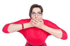 Beautiful plus size woman in glasses covering her mouth with han Stock Image