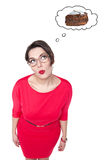 Beautiful plus size woman in glasses dreaming about cake Stock Image
