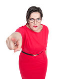 Beautiful plus size woman in glasses pointing finger at you Royalty Free Stock Photography