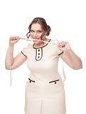 Beautiful plus size woman gnawing centimeter. On white background Royalty Free Stock Photography