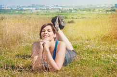 Beautiful plus size woman lying on the meadow outdoor Stock Image