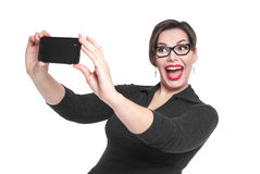 Beautiful plus size woman making picture of herself selfie isola. Ted on white background royalty free stock photo