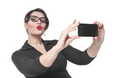 Beautiful plus size woman making picture of herself selfie isola Stock Photography