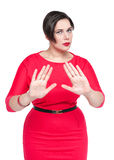 Beautiful plus size woman making stop gesture Royalty Free Stock Image