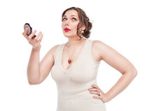 Beautiful plus size woman with mirror Royalty Free Stock Photography