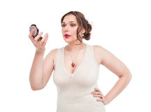 Beautiful plus size woman with mirror Royalty Free Stock Image