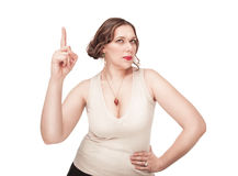 Beautiful plus size woman pointing up her finger Stock Photo