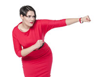 Beautiful plus size woman in red dress beating something Royalty Free Stock Images