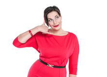 Beautiful plus size woman in red dress with call gesture isolate Stock Images
