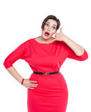 Beautiful plus size woman in red dress with call gesture isolate Stock Image