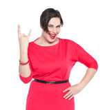 Beautiful plus size woman in red dress with horn gesture isolate. D on white background Royalty Free Stock Photos